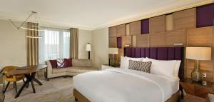 A bed or beds in a room at The Ritz-Carlton, Berlin