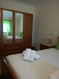 A bed or beds in a room at Casa Serra da Lapa