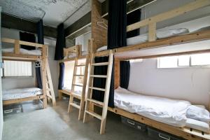 A bunk bed or bunk beds in a room at New World Inn