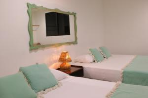 A bed or beds in a room at Punta Piedra Beach Posada