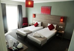 Cama o camas de una habitación en Spinola Hotel