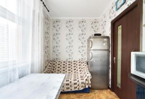 A bed or beds in a room at Апартаменты на Физкультурной, 6