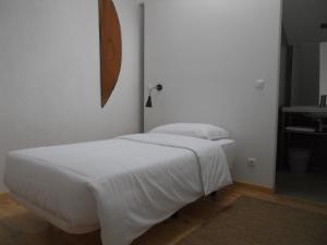 Uma cama ou camas num quarto em Casa de Campo Moinhos da Gozundeira