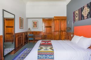 Cama ou camas em um quarto em Selina Cuenca