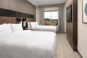 A bed or beds in a room at Residence Inn By Marriott Bend