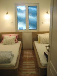 A bed or beds in a room at Apartments Sonne