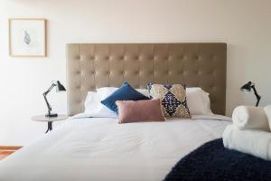 A bed or beds in a room at Belma Boutique Bed and Breakfast
