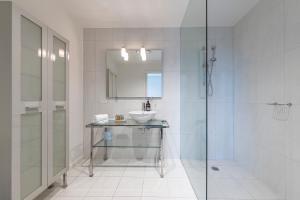 A bathroom at Canvas Suites on La Trobe