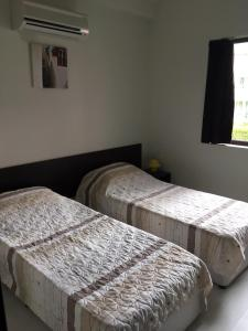 A bed or beds in a room at The White Houses Complex