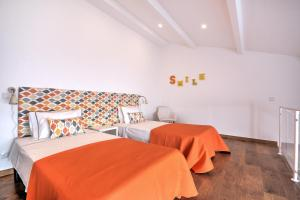 A bed or beds in a room at Terrace Barqueta Studio