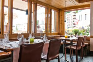 A restaurant or other place to eat at Hauser Hotel St. Moritz