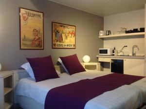 Ein Bett oder Betten in einem Zimmer der Unterkunft Melrose 'Puur Logies'