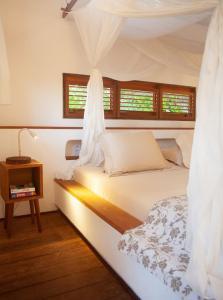 Cama ou camas em um quarto em La Ferme De Georges