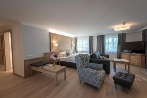 Ein Sitzbereich in der Unterkunft Hotel Gasthof Mostwastl