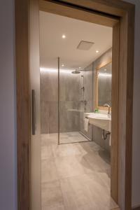Ein Badezimmer in der Unterkunft Hotel Gasthof Mostwastl