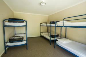 A bunk bed or bunk beds in a room at Fiordland Great Views Holiday Park
