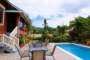 The swimming pool at or close to Heritage Inn Trinidad