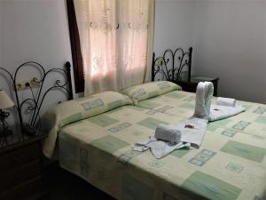 Cama o camas de una habitación en La Despensa del Valle