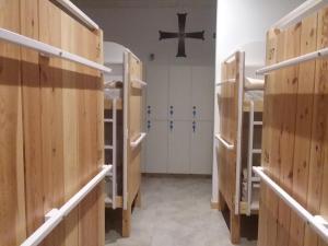 Litera o literas de una habitación en Albergue Milladoiro