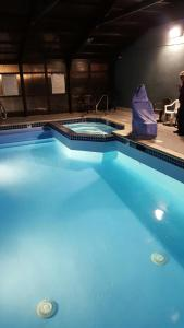 The swimming pool at or near Super 8 by Wyndham Logan