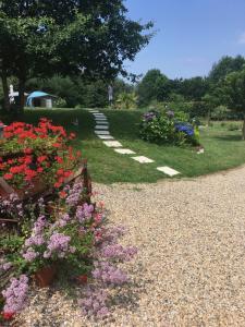Jardin de l'établissement Sous le Bois Gites