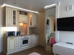 A kitchen or kitchenette at Apartments Gorskiy