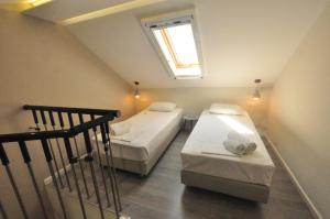 A bed or beds in a room at Tassos Apartments