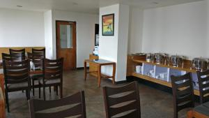 A restaurant or other place to eat at Hotel Ninamma