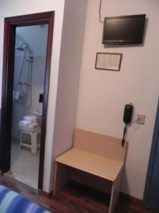 TV o dispositivi per l'intrattenimento presso Hotel Antonella