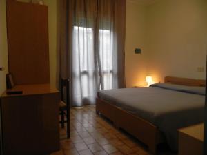 Letto o letti in una camera di Hotel Antonella