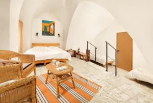 A bed or beds in a room at Fauzi Azar by Abraham Hostels