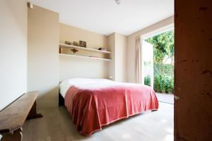 A bed or beds in a room at Park Appartement