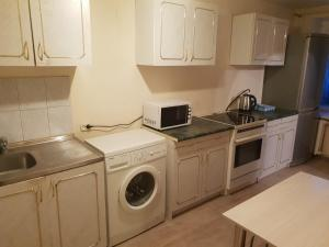 A kitchen or kitchenette at Apartment on Marshall Pokryshkin