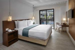 Quest Hotel Tagaytayにあるベッド