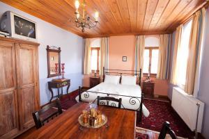 מיטה או מיטות בחדר ב-Hotel Machalas