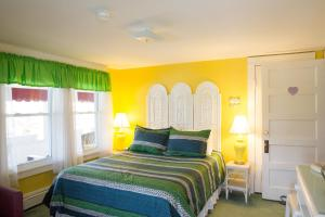 A bed or beds in a room at The Bentley Inn