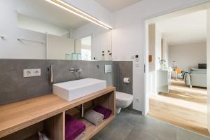 Ein Badezimmer in der Unterkunft Suites MITTE - Aparthotel