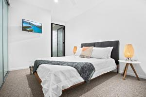 A bed or beds in a room at No 5 Rockpool 69 Ave Sawtell