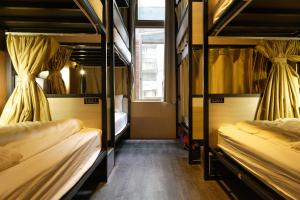 A bunk bed or bunk beds in a room at Angels Hostel Taipei Ximen