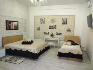 Кровать или кровати в номере Hotel Elit