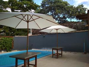 The swimming pool at or near Casa Frente Praia Porto Seguro