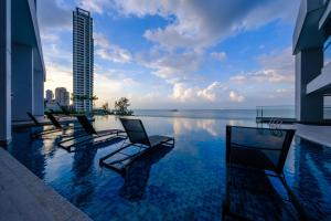 The swimming pool at or close to Tanjung Point Residences