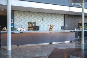 The lobby or reception area at Best Western Plus Hotel Groningen Plaza