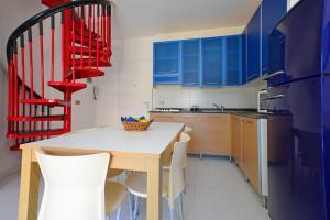 Kuchyň nebo kuchyňský kout v ubytování Parco Hemingway