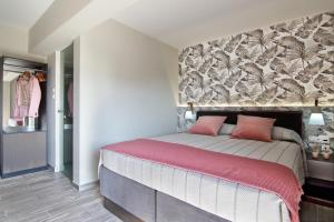 A bed or beds in a room at Maison 66, Riviera Hotels