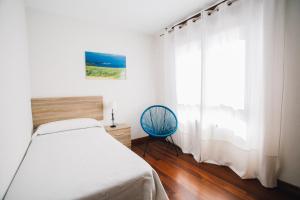 Cama o camas de una habitación en Apartamentos Alday