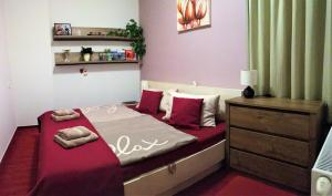 A bed or beds in a room at Apartmán Crocus 313