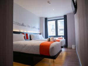 A bed or beds in a room at easyHotel Lisbon
