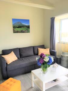 Uma área de estar em Casa do Almance