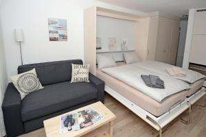 Ein Bett oder Betten in einem Zimmer der Unterkunft Studio 25 Davos Platz